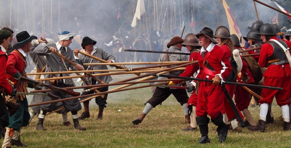 Pikemen engage musketeers during a re-enactment of the Siege of