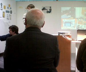 Falmouth University students presenting their designs to Sir Kenneth Grange